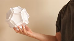 complexity -paper Dodecahedron in the hand - stock footage