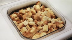 Croutons on a food display Stock Footage
