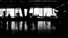 Stock Video Footage of Black and white silhouettes of people at airport check-in