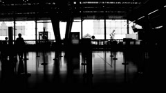 Stock Video Footage of Black and white silhouettes of people at airport check-in (slow motion)