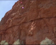 DIXIE NATIONAL FOREST  vehicle shot eroded red limestone cliff and pine trees Stock Footage