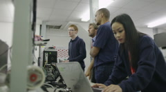Team of workers in an electronics factory working on computer testing and repair - stock footage