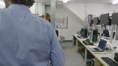 Timelapse of busy team of workers testing computers in electronics factory - stock footage