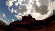 Stock Video Footage of Dramatic Sun Lit Clouds Over Bell Rock- Sedona Arizona