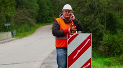 Worker with wrench repairing road sign Stock Footage