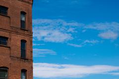 Building with a bright blue sky Stock Photos