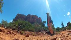 Man Hiking Bell Rock Trail Stops To Admire View- Sedona AZ - stock footage