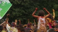 Adults and children dancing, jumping, waving hands at festival Footage