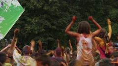 Adults and children dancing, jumping, waving hands at festival Stock Footage
