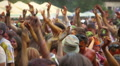 Young guys, girls dancing at festival, waving hands to music Footage