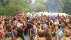 Dancing crowd covered in colorful paint, people enjoying fest Stock Footage