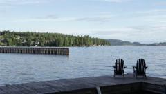 Chairs on a dock in the morning Stock Footage