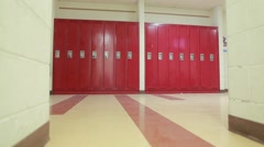 Wide push shot of red lockers in hallway - stock footage