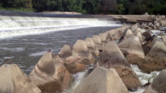 Stony shore in the background of a waterfall Stock Footage