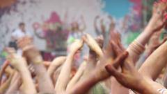 People waving and clapping hands at concert, enjoying music Stock Footage