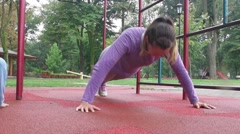 Dolly shoot of young girl doing push ups Stock Footage