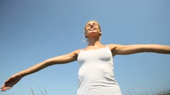woman doing relaxation exercising, stretching arms up - stock footage