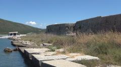 AGIA MAVRA. Old dock. Ancient remains of a harbor near a Moorish fortress. Stock Footage
