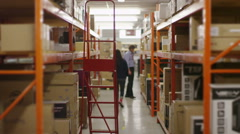 Timelapse of busy workers in a warehouse or factory  - stock footage