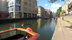 A Canal Narrow boat on the Regents Canal at Kings Cross, London Stock Footage
