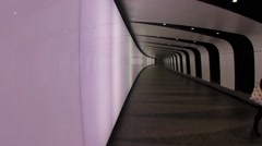 Kings Cross Light Tunnel Passengers for London's Kings Cross Station walk down t Stock Footage