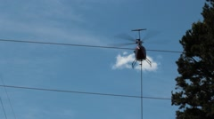 Helicopter flies near power lines - stock footage