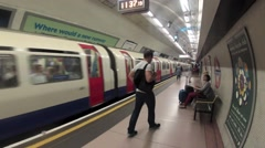 A Tube train pulls out of Angel Underground station Stock Footage