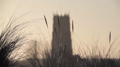 Winterton church tower viewed through dunes grass Stock Footage