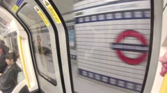 A Tube Train pulls into Leicester Square station in Central London Stock Footage