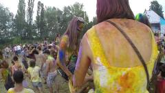 Young girls sitting on boyfriends' shoulders at festival, slowmo, click for HD Stock Footage