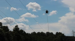A helicopter hovers above the tree line Stock Footage