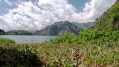 Grass and mountains lake Stock Footage