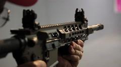 Firing an AR-15 assault rifle Stock Footage