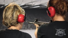 Female Instructor Teaches Proper Handling of Assault Weapon - stock footage