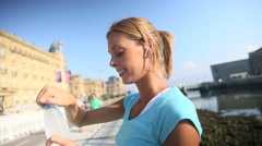 Jogger woman drinking water from bottle Stock Footage