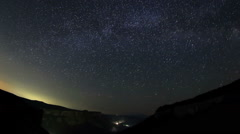 Time lapse of stars behind mountain Stock Footage