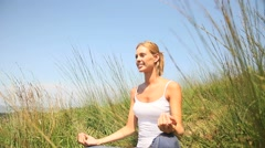 Woman in countryside doing yoga exercices Stock Footage