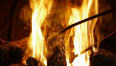 Fireplace tong moving wood log in the fire Stock Footage