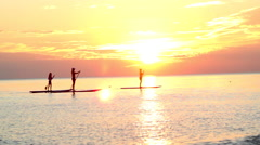 Sunset Paddle Boarding, 3 People Stock Footage