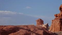 Pan CU of red rock hoodoos, blue sky in Goblin Valley state park. - stock footage