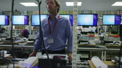 Team of workers building and testing computers in a British electronics factory Stock Footage