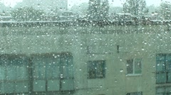 It's raining behind the window Stock Footage