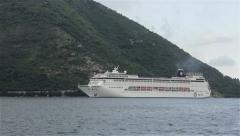 3/4 Cruiser carrying passengers. Cruise ship passes through the sea bay. Stock Footage