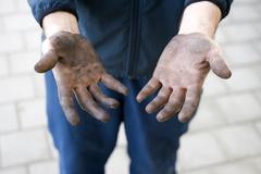manual labourer with dirty hands - stock photo
