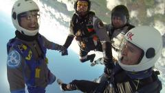California USA, January 2015: Team of skydivers in free fall from plane - stock footage