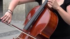 ULTRA HD 4K Closeup woman play violoncello instrument street music downtown city - stock footage
