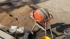 ULTRA HD 4K Aerial view concrete electric machine mixing cement construction day Stock Footage