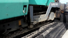 Road work. Machine for paving apply asphalt to street. Machine pouring asphalt. Stock Footage