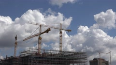ULTRA HD 4K Crane machine work top skyscraper town blue sky sunny summer day Stock Footage