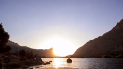 Mountain Lake. Day follows night. Pamir, Tajikistan. Time Lapse. 4K Stock Footage